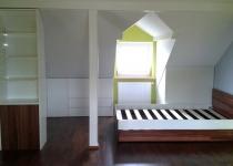 Zabudowa poddasza - szafki i półki na poddaszu